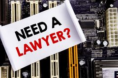 Word, writing Need A Lawyer. Business concept for Advocacy Justice Help Written on sticky note, computer main board background. Word, writing Need A Lawyer stock photos