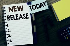 Word, writing New Release . Business concept for Technology Software Update written on book note paper on the wooden background. W. Word, writing New Release stock image
