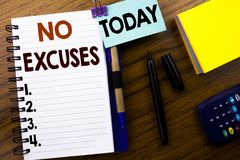 Word, writing No Excuses. Business concept for Stop Ban for Excuse written on book note paper on the wooden background. With attac Stock Images