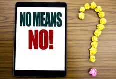 Word, writing No Means No. Business concept for Stop Anti Rape Slogan Written on tablet, wooden background with question mark on t. Word, writing No Means No Royalty Free Stock Photography