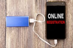 Word, writing Online Registration. Business concept for Internet Login written on mobile cell phone mobile and power-bank charger. Word, writing Online stock images