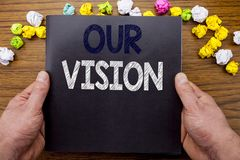 Word, writing Our Vision. Business concept for Marketing Strategy Vision written on notepad notebook book on the wooden wood backg Royalty Free Stock Image