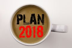Word, writing Plan 2018 text in coffee in cup. Business concept for Strategy Action Plan 2018 on white background with copy space. Word, writing Plan 2018 text Stock Photography