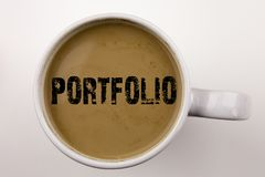 Word, writing Portfolio text in coffee in cup. Business concept for Business Marketing Design on white background with space. Blac stock photo