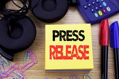 Word, writing Press Release. Business concept for Statement Announcement Message written on sticky note paper on the wooden backgr. Word, writing Press Release Stock Photos