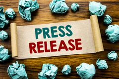 Word, writing Press Release. Business concept for Statement Announcement Message Written on sticky note paper, wooden background w. Word, writing Press Release Royalty Free Stock Photo