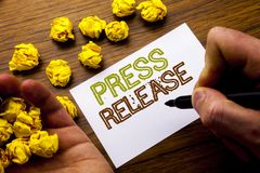 Word, writing Press Release. Concept for Statement Announcement Message written on notebook note paper on the wooden background wi. Word, writing Press Release Stock Photos