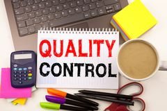 Word writing Quality Control in the office with surroundings such as laptop marker pen stationery coffee Business concept for Prod Royalty Free Stock Images