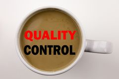 Word, writing Quality Control text in coffee in cup Business concept for Product Improvement or Check on white background with cop Stock Images