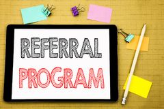 Word, writing Referral Program. Business concept for Refer Marketing  Written on tablet laptop, wooden background with sticky note. Word, writing Referral Stock Photo