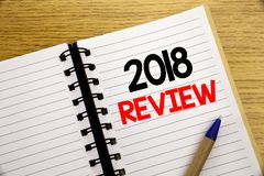 Word, writing 2018 Review. Business concept for Feedback On Progress written on notepad with copy space on old wood wooden backgro. Word, writing 2018 Review royalty free stock photography