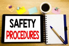 Word, writing Safety Procedures. Business concept for Accident Risk Policy Written on tablet laptop, wooden background with sticky. Word, writing Safety Stock Images