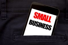 Word, writing Small Business. Business concept for Strategy Management Written phone mobile phone, cellphone placed in the man fro. Word, writing Small Business royalty free stock photography