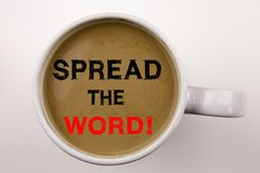 Word, writing Spread The Word text in coffee in cup Business concept for Announcement Business Marketing Message on white backgrou. Nd with space Black text with royalty free stock images