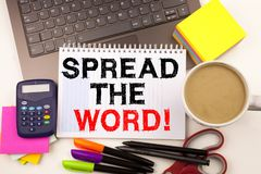 Word writing Spread The Word in the office with surroundings such as laptop marker pen stationery coffee Business concept for Anno. Uncement Business Marketing royalty free stock photos