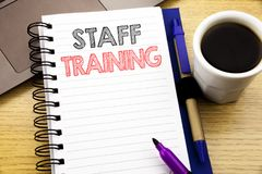 Word, writing Staff Training. Business concept for Teaching or Education written on notebook book on the wooden background in the. Word, writing Staff Training Stock Image