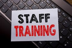 Word, writing Staff Training. Business concept for Teaching or Education written on sticky note paper on the dark keyboard backgro. Word, writing Staff Training Royalty Free Stock Images