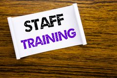 Word, writing Staff Training. Business concept for Teaching or Education written on sticky note paper on the wooden wood structure. Word, writing Staff Training royalty free stock photography