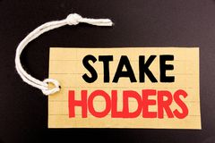 Word, writing Stake Holders. Business concept for online sale Stakeholder Engagement written on price tag paper on the black vinta. Word, writing Stake Holders stock photography