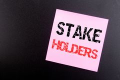Word, writing Stake Holders. Business concept for Stakeholder Engagement written on sticky note, black background with copy space. Word, writing Stake Holders royalty free stock photo
