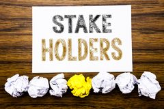 Word, writing Stake Holders. Concept for Stakeholder Engagement Written on sticky note paper reminder, wooden background with stic. Word, writing Stake Holders royalty free stock photo