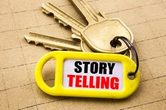 Word, writing Storytelling. Business concept for Teller Story Message Written on key holder, textured background close up. Word, writing Storytelling. Business Royalty Free Stock Photos