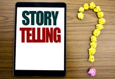 Word, writing Storytelling. Business concept for Teller Story Message Written on tablet, wooden background with question mark on t. Word, writing Storytelling Stock Photo