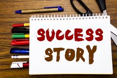 Word, writing Success Story. Business concept for Inspiration Motivation Written on notebook, wooden background with office equipm. Word, writing Success Story Royalty Free Stock Photos