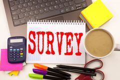 Word writing Survey in the office with laptop, marker, pen, stationery, coffee. Business concept for Opinion Feedback Research Con Stock Image