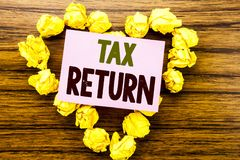 Word, writing Tax Return. Business concept for Taxation Refund written on sticky note paper on the wooden background. Word, writing Tax Return. Business concept Royalty Free Stock Photos
