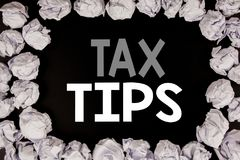 Word, writing Tax Tips. Business concept for Taxpayer Assistance Refund Reimbursement written on black background with copy space. On background with folded Stock Photo