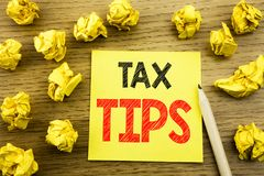 Word, writing Tax Tips. Business concept for Taxpayer Assistance Refund Reimbursement written on sticky note paper on the wooden b. Word, writing Tax Tips Royalty Free Stock Photos