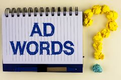 Word writing text Ad Words. Business concept for Advertising a business over first of internet search results written on Notebook stock photos