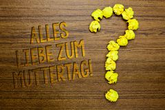 Word writing text Alles Liebe Zum Muttertag. Business concept for Happy Mothers Day Love Good wishes Affection Wooden floor with s. Ome letters yellow paper royalty free stock image