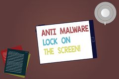Word writing text Anti Malware Lock On The Screen. Business concept for Security safety against malware hacking Tablet Empty stock image