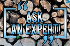 Word writing text Ask An Expert. Business concept for Consult a Professional Asking for Advice Make a Question Wooden background. Vintage wood wild message royalty free stock photos