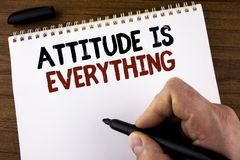 Word writing text Attitude Is Everything. Business concept for Motivation Inspiration Optimism important to succeed written by Man. Notepad holding Marker the Stock Photo