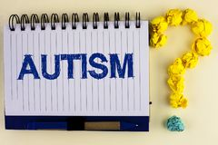 Word writing text Autism. Business concept for Autism Awareness conducted by social committee around the globe written on Notebook. Word writing text Autism Stock Photo