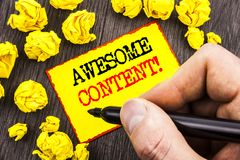 Word, writing, text  Awesome Content. Business concept for Creative Strategy Education Website Concept written By Man Holding Mark. Er Sticky Note Paper Royalty Free Stock Photos