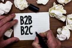 Word writing text B2B B2C. Business concept for two types for sending emails to other people Outlook accounts Man holding marker n. Otebook page crumpled papers stock images
