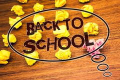Word writing text Back To School. Business concept for Return to class first day of studies Classroom Arriving Text wood desk crum. Bled paper notes yellow pink royalty free stock images