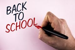 Word writing text Back To School. Business concept for Right time to purchase schoolbag, pen, book, stationary written by Man hold stock image