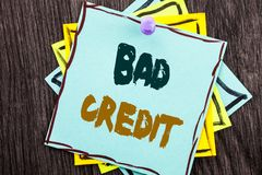 Word, writing, text  Bad Credit. Business concept for Poor Bank Rating Score For Loan Finance written on Blue Sticky Note Paper on. Word, writing, text  Bad Stock Images