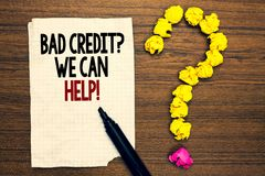 Word writing text Bad Credit question We Can Help. Business concept for Borrower with high risk Debts Financial Written torn page. Touch black pen yellow paper royalty free stock photos