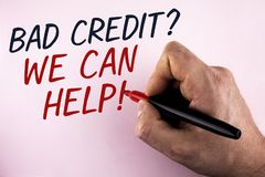Word writing text Bad Credit Question We Can Help Motivational Call. Business concept for achieve good debt health written by Man. Holding Marker in Hand plain stock photo