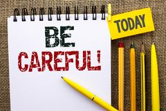Word writing text Be Careful. Business concept for Caution Warning Attention Notice Care Beware Safety Security written on Noteboo stock photography