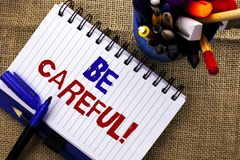 Word writing text Be Careful. Business concept for Caution Warning Attention Notice Care Beware Safety Security written on Noteboo stock image