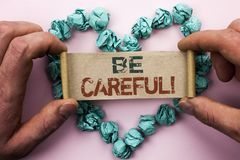 Word writing text Be Careful. Business concept for Caution Warning Attention Notice Care Beware Safety Security written on Cardboa. Word writing text Be Careful Royalty Free Stock Photography