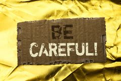 Word writing text Be Careful. Business concept for Caution Warning Attention Notice Care Beware Safety Security written on tear Ca. Word writing text Be Careful Royalty Free Stock Photo