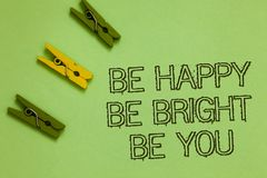 Word writing text Be Happy Be Bright Be You. Business concept for Self-confidence good attitude enjoy cheerful Outline words green. Middle yellow paper clip on stock image